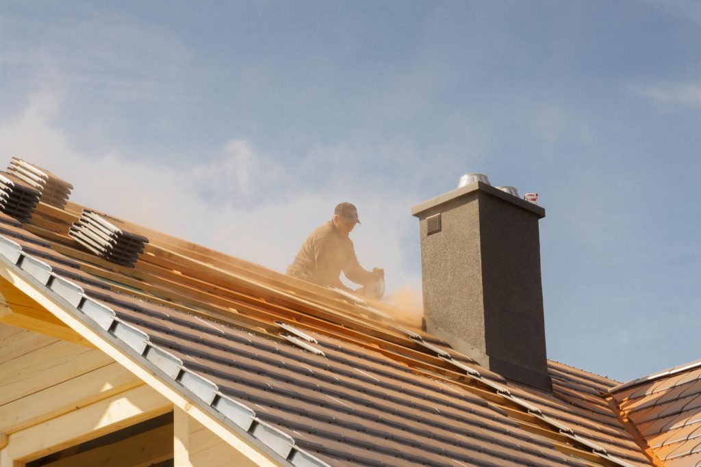 man installing the roof tile