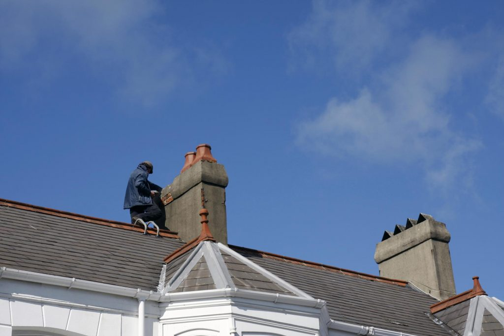 man fixing the chimney